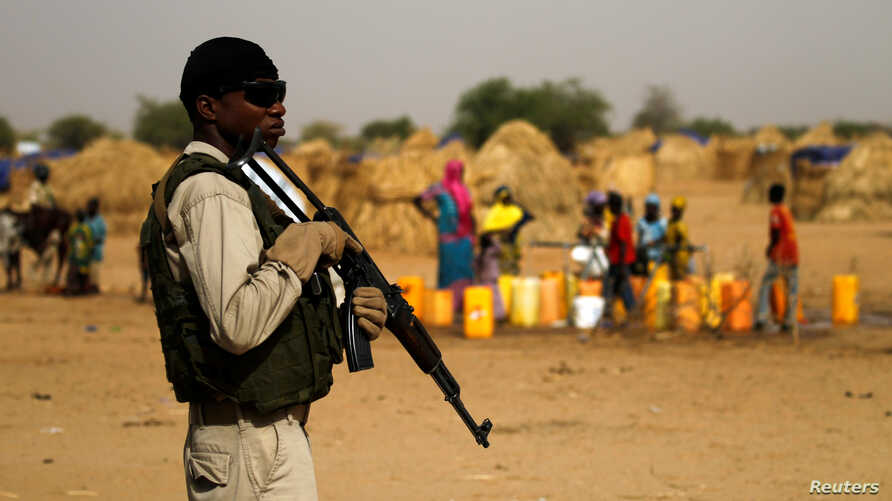 FILE - A Nigerien soldier stands guard in a camp in the city of Diffa following attacks by Boko Haram fighters in Niger's Diffa region, June 18, 2016.