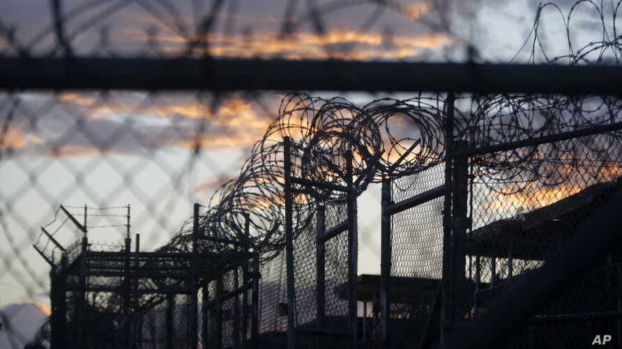 FILE - Dawn arrives at the now-closed Camp X-Ray, which was used as the first detention facility for al-Qaida and Taliban militants who were captured after the Sept. 11 attacks, at the Guantanamo Bay Naval Base, Cuba. The Obama administration is tran
