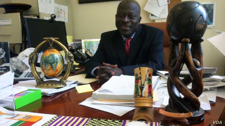 Ghana-born Kofi Boateng, director of the West Harlem Development Corporation, is helping to organize community forums where West Africans can get accurate information about Ebola in order to quell fears and remain healthy, New York City, Oct. 28, 201