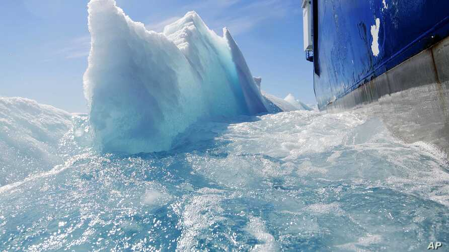 Broken sea ice emerges from under the hull of the Finnish icebreaker MSV Nordica as it sails through the Victoria Strait while traversing the Arctic's Northwest Passage, July 21, 2017.