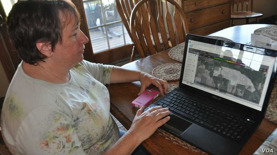 Shelley Finfrock has been testing Climate Basic to check the accuracy of its rainfall estimates and other features. (V. LaCapra/VOA)