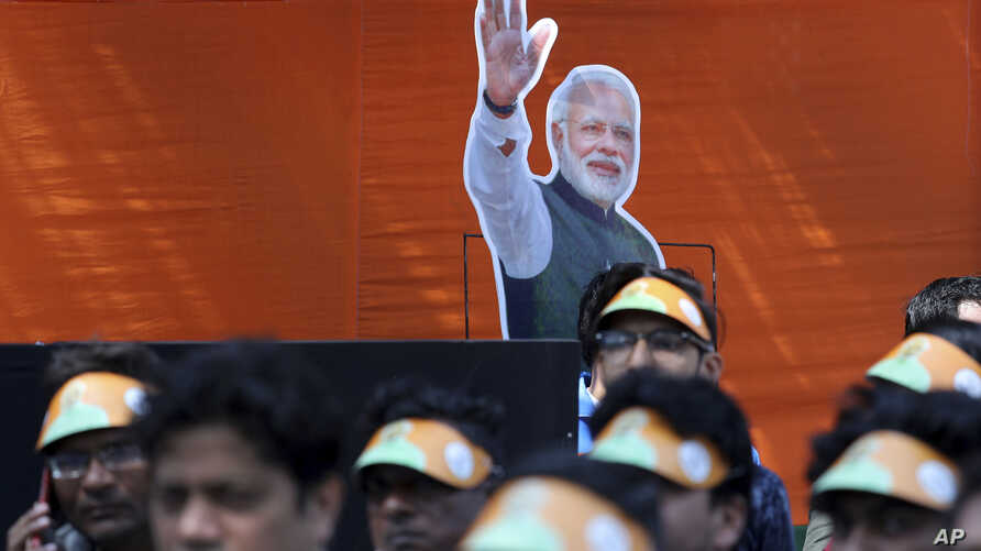 FILE - India's Bharatiya Janata Party workers listen to Prime Minister Narendra Modi addressing them via video conference in New Delhi, India, Feb.28, 2019.