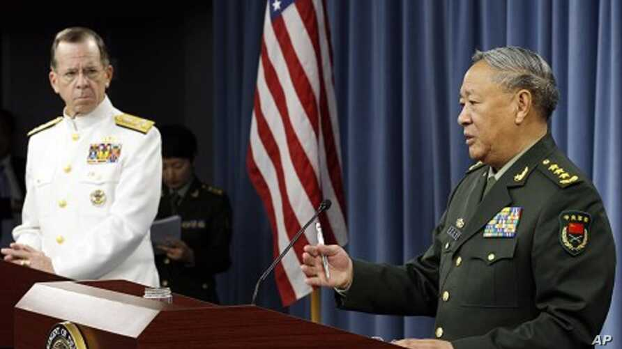 Chairman of the Joint Chiefs of Staff Adm. Mike Mullen, left, and China's Gen. Chen Bingde speak during a media availability at the Pentagon, Washington, May 18, 2011