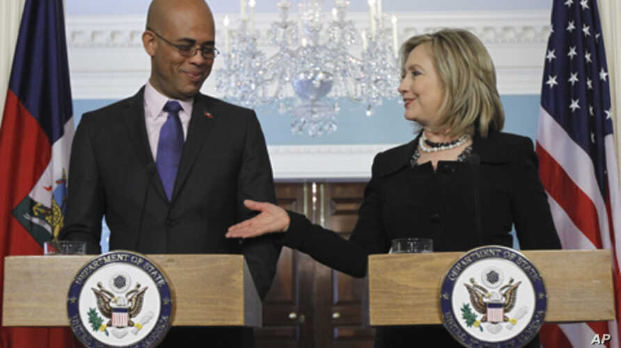 U.S. Secretary of State Hillary Rodham Clinton and Haiti's President-elect Michel Martelly take part in a joint news conference at the State Department, April 20, 2011