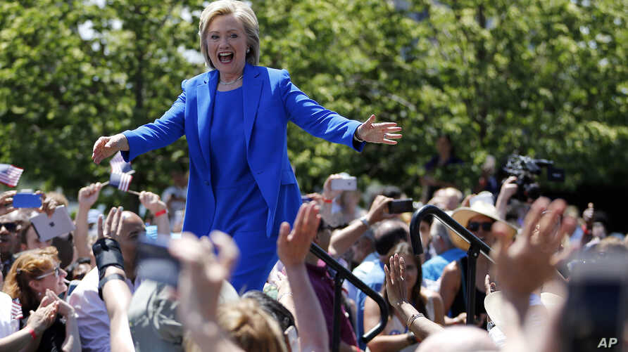 Hillary Clinton greets supporters upon her arrival for a speech at Roosevelt Island in New York at the first major rally of her 2016 campaign for the presidency, June 13, 2015.