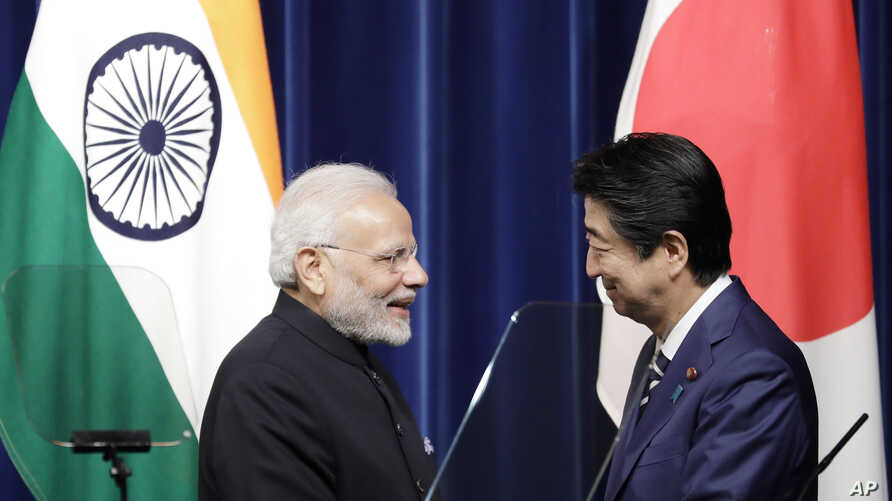 Indian Prime Minister Narendra Modi, left, and Japan's Prime Minister Shinzo Abe face during a joint news conference at Abe's official residence in Tokyo Monday, Oct. 29, 2018.