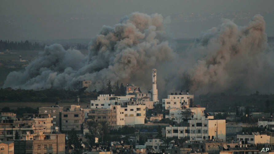 FILE - Smoke rises from explosions caused by Israeli military operations in Gaza City, Jan. 13, 2009. Israel fired white phosphorous shells indiscriminately over densely populated areas of Gaza in what amounts to a war crime, Human Rights Watch said