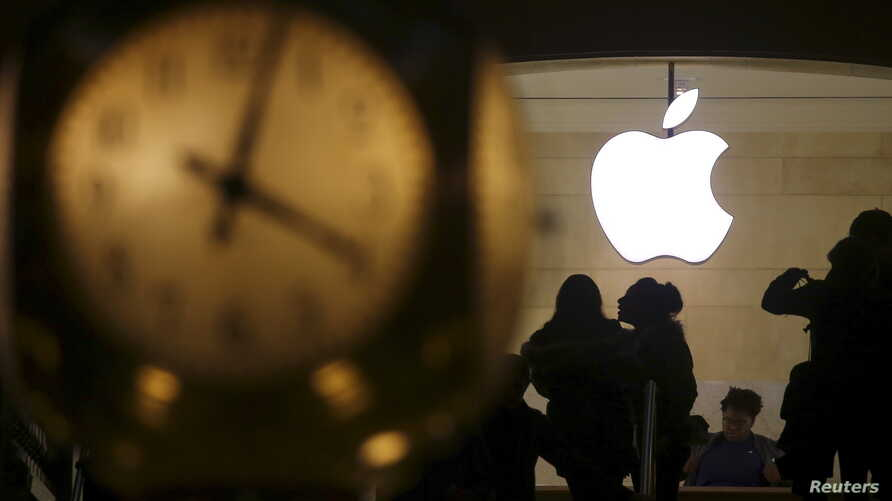 The Apple logo is pictured behind the clock at Grand Central Terminal in the Manhattan borough of New York, Feb. 21, 2016.