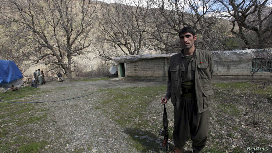 A Kurdistan Workers Party (PKK) fighter stands guard at the Qandil mountains near the Iraq-Turkish border in Sulaimaniya, 330 km northeast of Baghdad March 24, 2013.