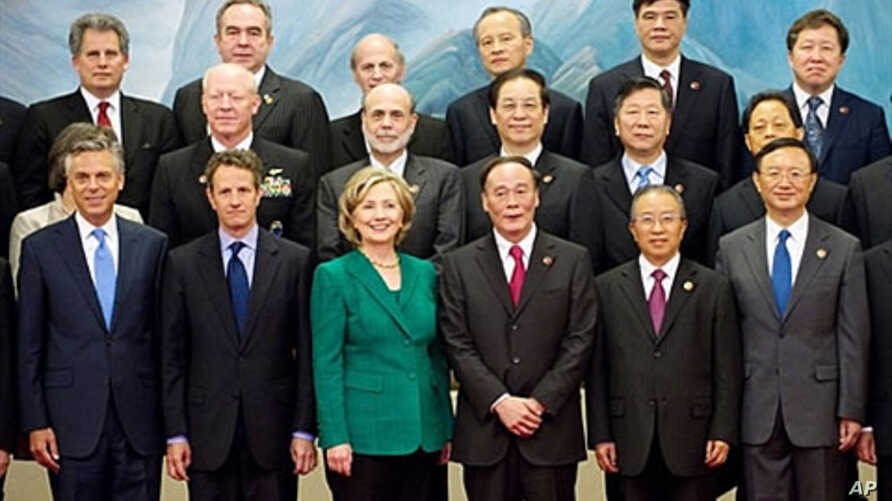 Chinese Vice-Premier Wang Qishan (3rd R) stands alongside Chinese State Councilor Dai Bingguo (2nd R), U.S. Secretary of State Hillary Clinton (C) and U.S. Secretary of Treasury Timothy Geithner (2nd L) at the Great Hall of the People in Beijing, 24