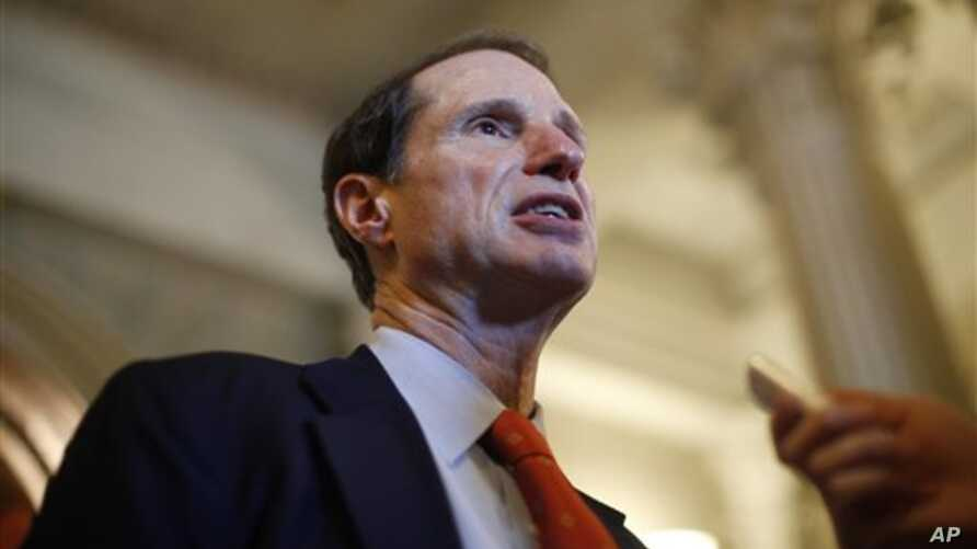 In this April 2011 file photo, Senator Ron Wyden speaks to reporters after leaving the Senate on Capitol Hill in Washington. Wyden, a member of the Senate Intelligence Committee, says that he, like the public, is being kept in the dark about Justice