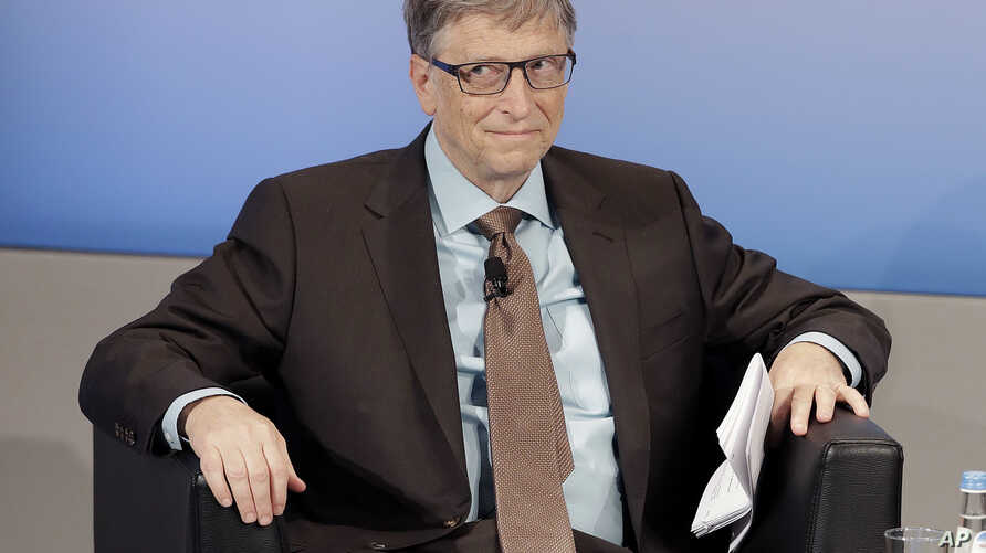 Microsoft founder Bill Gates sits in his chair during the Munich Security Conference in Munich, Germany, Saturday, Feb. 18, 2017.