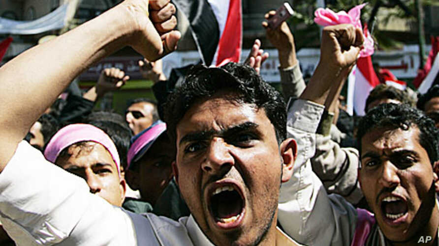 Opposition supporters shout slogans during an anti-government protest in Sanaa, February 3, 2011