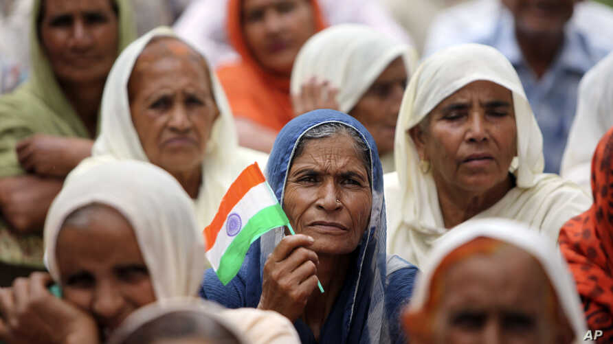 Hindus who migrated from Pakistan to Jammu in 1947 participate in a protest demanding citizenship rights in Jammu, India, Sept. 8, 2012.