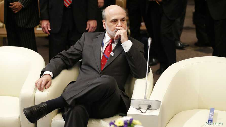 U.S. Federal Reserve Chairman Ben Bernanke is seen prior to the International Monetary and Financial Committee at the annual meetings of the IMF and the World Bank Group in Tokyo, October 13, 2012.