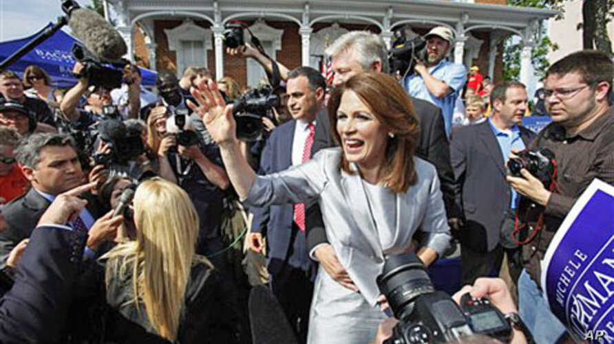 Representative Michele Bachmann, Republican from Minnesota, waves to supporters after making her formal announcement to seek the 2012 Republican presidential nomination in Waterloo, Iowa, June 27, 2011