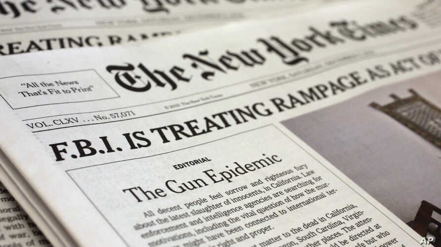 An editorial appears on the front page of the New York Times, in New York, Dec. 5, 2015. The newspaper used the space on its front page to call for greater gun regulation in the wake of recent deadly mass shootings.