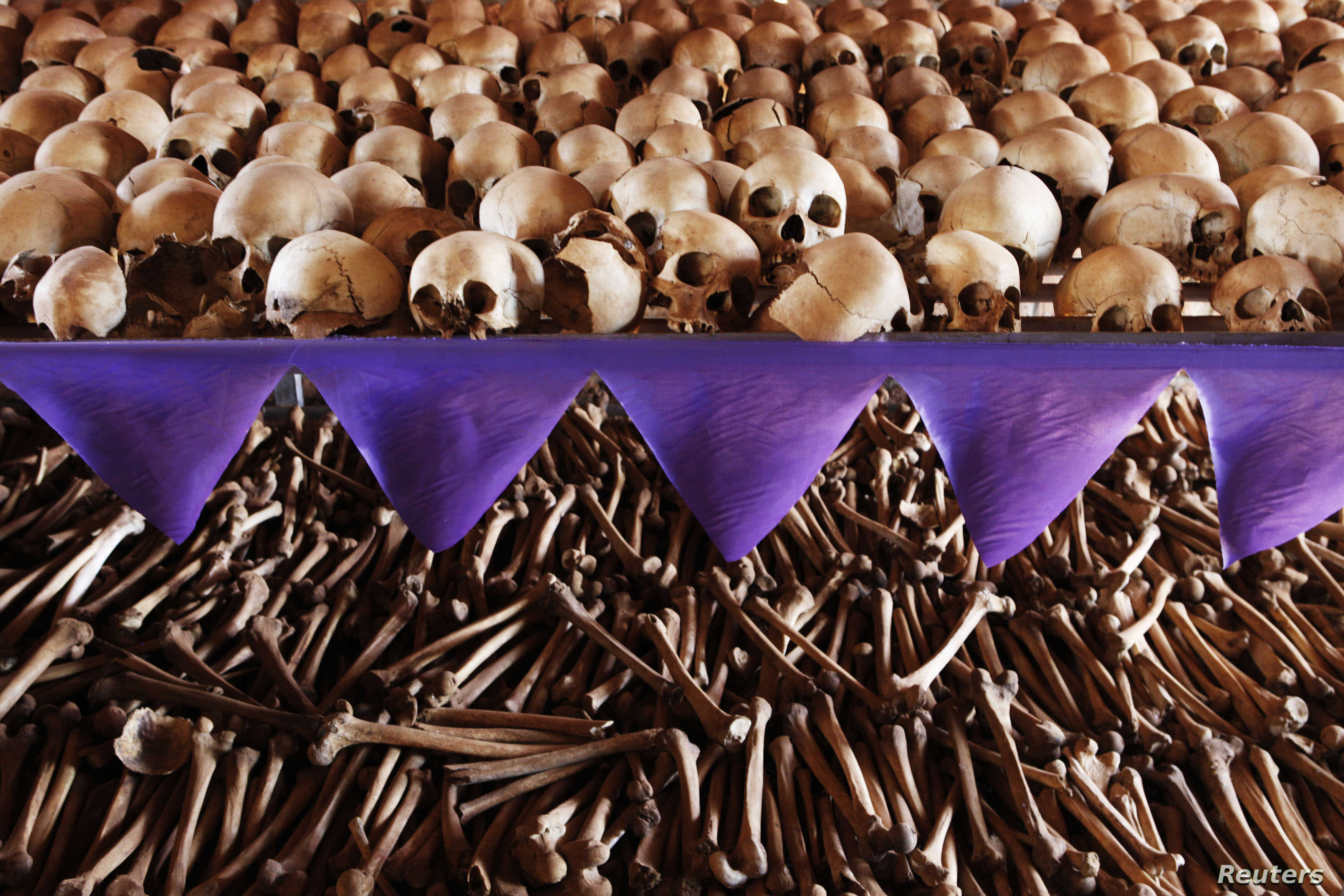 The skulls and bones of Rwandan victims rest on shelves at a genocide memorial inside the church at Ntarama just outside the capital Kigali, August 6, 2010.