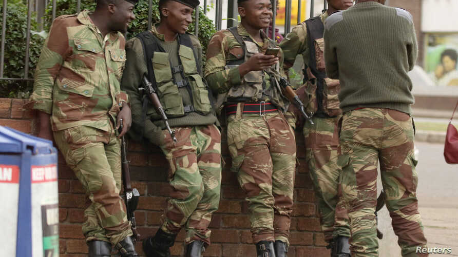 Soldiers are seen on the street in central Harare, Zimbabwe, Nov. 16, 2017.