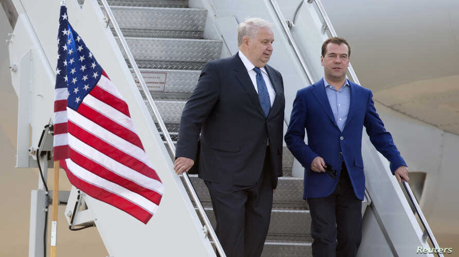 FILE - Russian Prime Minister Dmitry Medvedev, right, walks with Sergey Kislyak, Russian ambassador to the U.S., as he arrives for the G8 Summit at Dulles International Airport in Chantilly, Va., May 18, 2012.