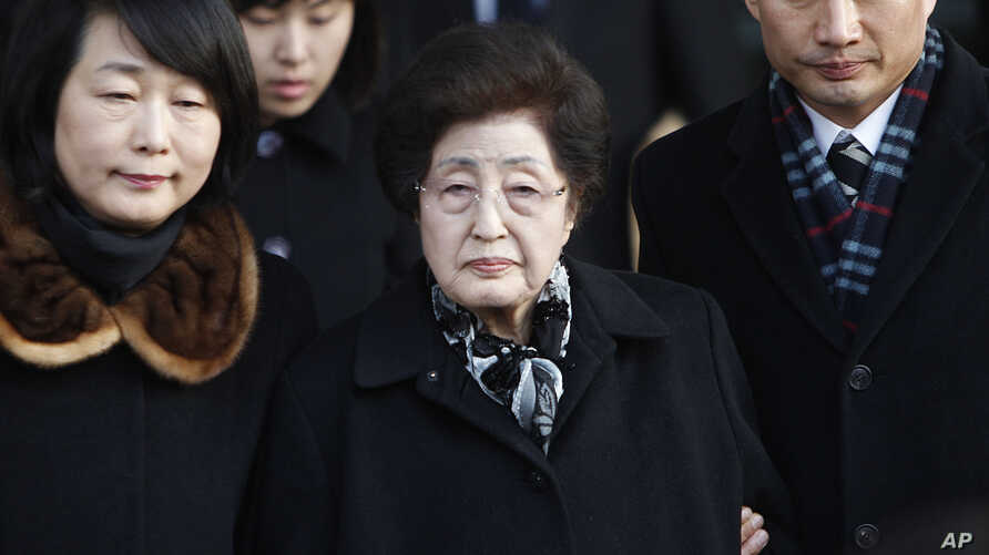 FILE - Lee Hee-ho, center, the wife of the late former South Korean President Kim Dae-jung, arrives at the Inter-Korean Transit Office from North Korea at the border village of Paju in the demilitarized zone, South Korea, Dec. 27, 2011.