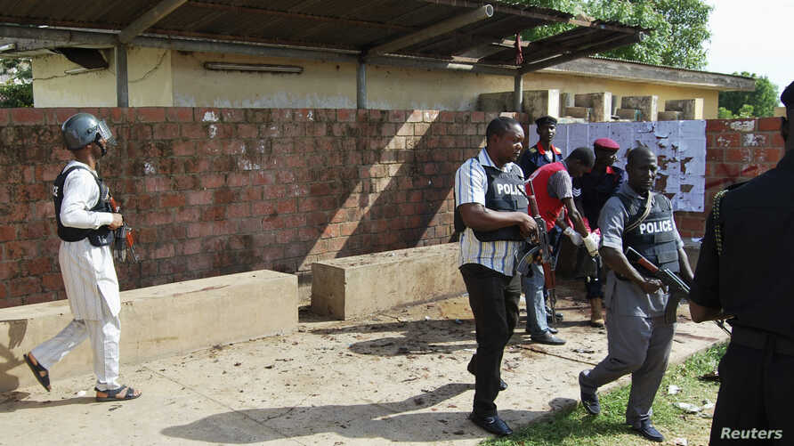 Security officers patrol the Kano State Polytechnic campus in northern Nigeria, where a female suicide bomber blew herself up July 30, 2014.