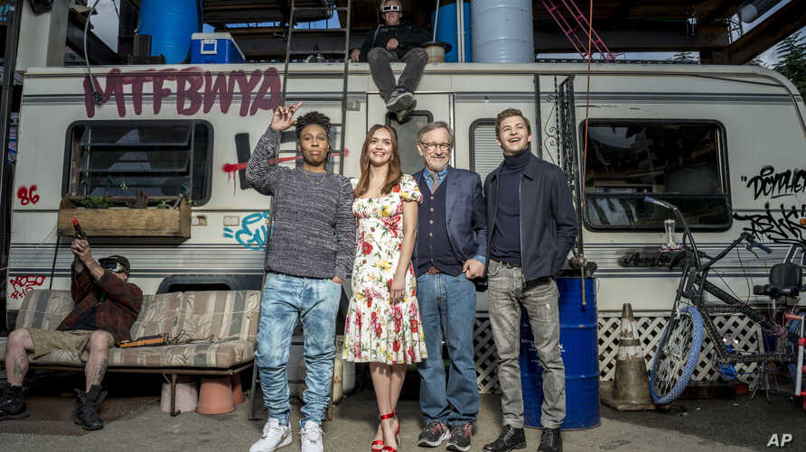 "In this March 16, 2018 photo, Tye Sheridan, from right, Steven Spielberg, Oliva Cooke, and Lena Waithe pose for a portrait at the interactive ""Ready Player One"" pop-up on Hollywood and Vine in Los Angeles."