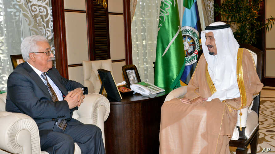 Palestinian President Mahmoud Abbas, left, meets with Saudi Arabia's Crown Prince Salman bin Abdulaziz in Jeddah, Saudi Arabia, Wednesday, June 18, 2014. Abbas said his forces are helping in the search for three Israeli teens missing in the West Bank