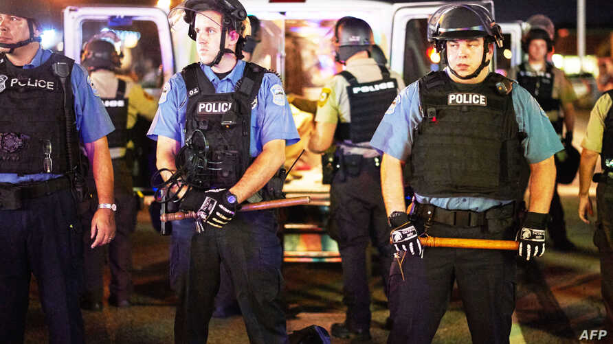 Police deployed during a civil disobedience action on Aug. 10, 2015 on West Florissant Avenue in Ferguson, Missouri.