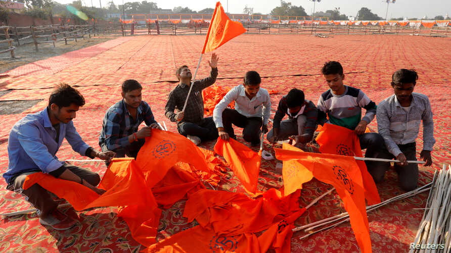 "Supporters of the Vishva Hindu Parishad (VHP), a Hindu nationalist organization, prepare flags at the venue of Sunday's ""Dharma Sabha"" or a religious congregation organized by VHP, in Ayodhya, Uttar Pradesh, India, Nov. 24, 2018."