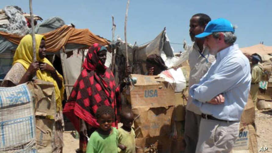 UN Deputy High Commissioner for Refugees, T. Alexander Aleinikoff, talks to internally displaced people at a camp in Bossaso, a city in the northern state of Puntland, Somalia (file photo)