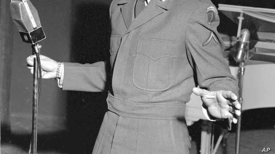 """Pfc. Vic Damone, former radio, TV and stage singer, presently assigned to the 7729 Special Services Group, made an appearance at the European premier of a new film musical """"Rich, Young, and Pretty"""" at the American Theater in Nuremberg, Dec. 7, 1951."""