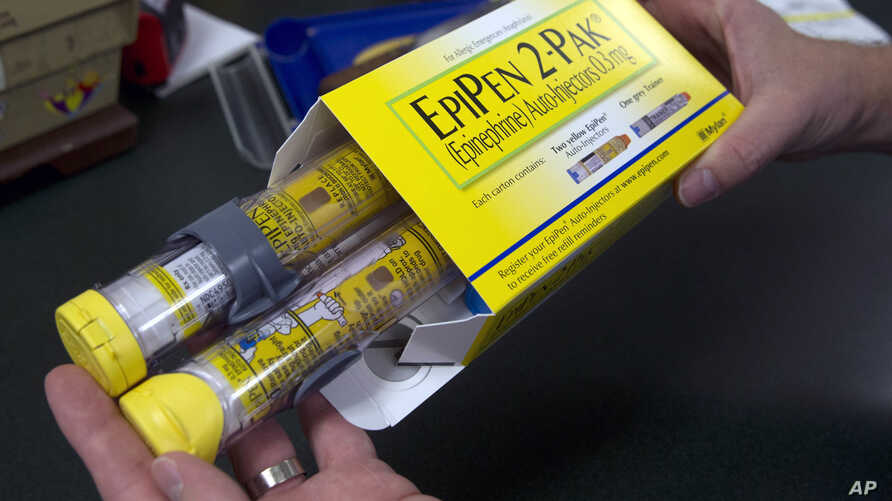 FILE - A pharmacist holds a package of EpiPens epinephrine auto-injector, a Mylan product, in Sacramento, Calif., July 8, 2016. Mylan has a generic version of its emergency allergy treatment and a new competitor has been given FDA approval.