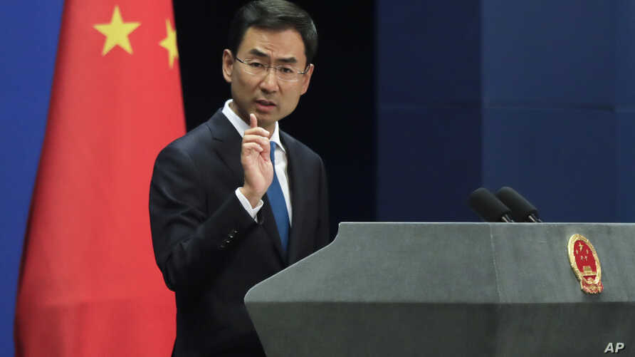 FILE - Chinese Foreign Ministry spokesman Geng Shuang speaks during a daily briefing at ministry offices in Beijing, Sept. 4, 2017. The ministry's website on Sept. 22, 2018, called U.S. imposition of sanctionsin response to China's purchase of milit