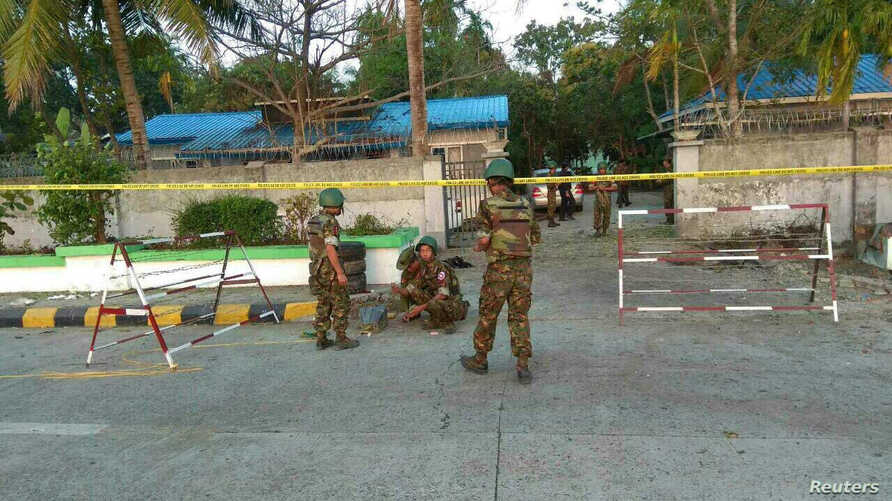 Security personnel investigate at the site of an explosion in Sittwe, Rakhine state, Myanmar, Feb. 24, 2018, in this picture obtained from social media. Courtesy of Ministry of Information Webportal Handout/via Reuters.