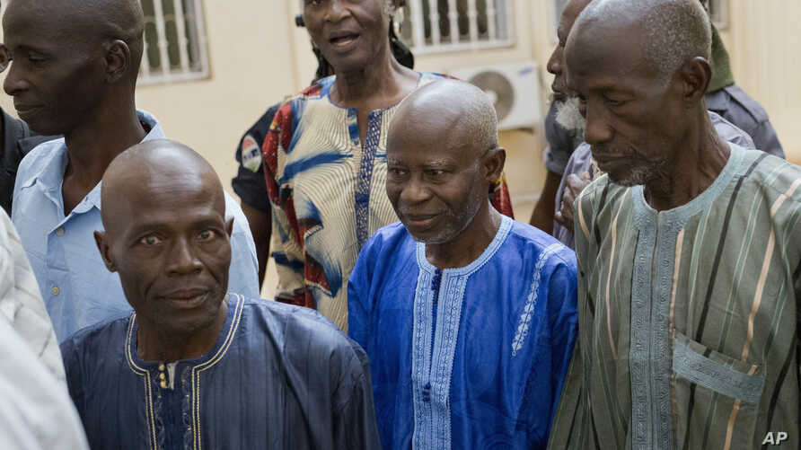Ousainou Darboe, the head of the United Democratic Party (C)  arrives with 18 others for their hearing at Gambia's supreme court in Banjul, Dec. 5, 2016. They had been arrested in April after they took part in a peaceful demonstration and sentenced t