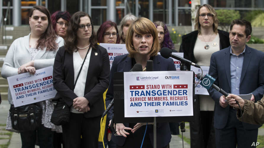 Gender Justice League executive director Danni Askini speaks during a press conference following oral arguments in a case to block a transgender military ban at the U.S. Western District Federal Courthouse on March 27, 2018 in Seattle.
