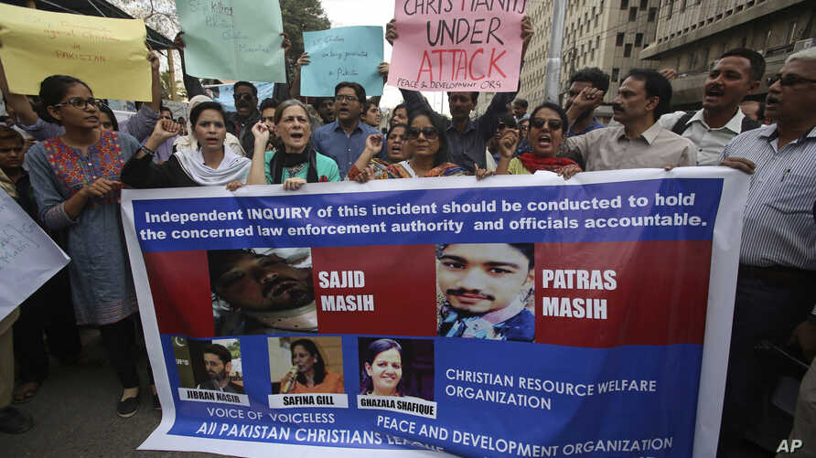 Supporters of Pakistani civil society groups protest in favor of the Christian community in Karachi, Pakistan, Feb. 26, 2018.