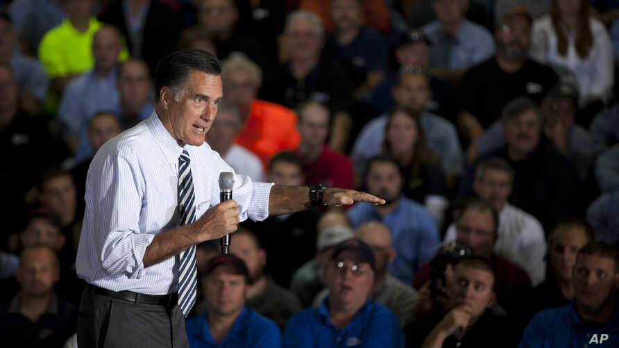 Republican presidential candidate, former Massachusetts Gov. Mitt Romney gestures during a town hall meeting at Ariel Corporation in Mt. Vernon, Ohio, October 10, 2012.