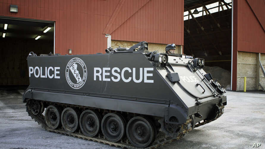 FILE - A police officer in Richboro, Pa., stands atop an Armored Personnel Carrier during a demonstration for the press, Jan. 23, 2007.