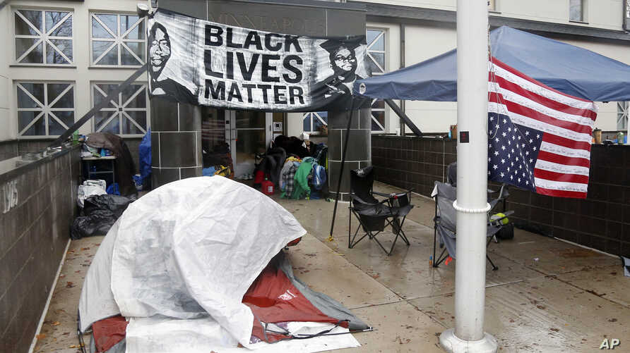 Members of Black Lives Matter continue their encampment outside the Minneapolis Police Department's Fourth Precinct, Nov. 17, 2015.