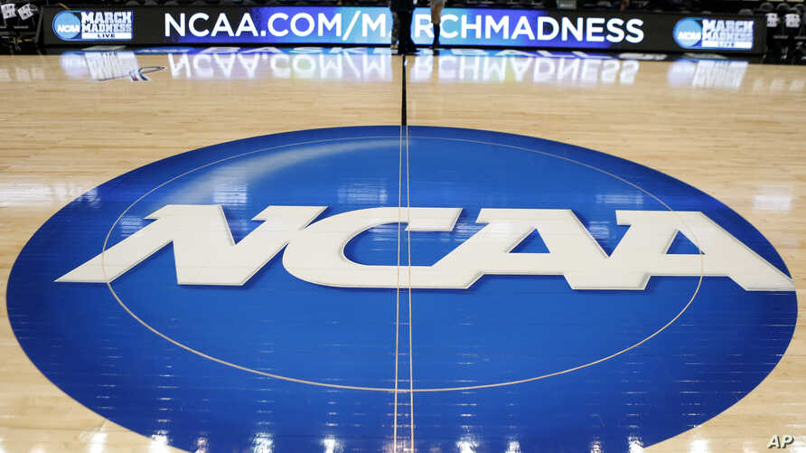 FILE - The NCAA logo is seen at center court at The Consol Energy Center in Pittsburgh, Pa., March 18, 2015.