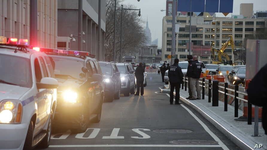 """FILE - The motorcade with Joaquin """"El Chapo"""" Guzman arrives at Brooklyn Federal Court in New York, Jan. 20, 2017. Guzman was brought to the United States from Mexico Jan. 19 to face drug trafficking and other charges."""