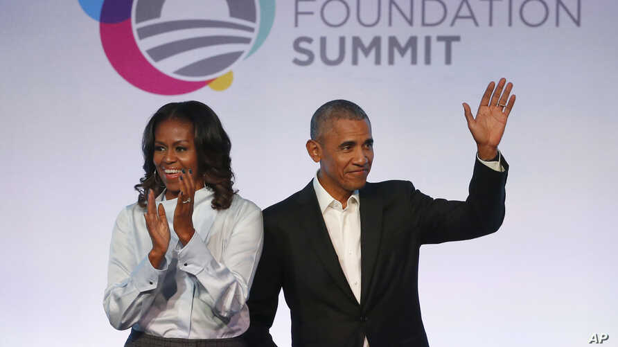 FILE - Former President Barack Obama, right, and former first lady Michelle Obama arrive for the first session of the Obama Foundation Summit in Chicago, Oct. 13, 2017.