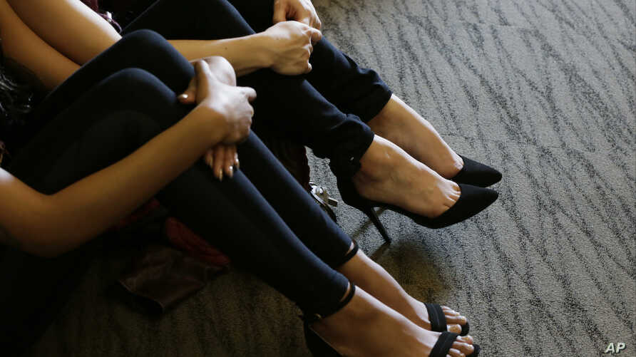 FILE - Members of the Club Owners Against Sex Trafficking learn how to spot sex traffickers in Burbank, Calif., Jan. 12, 2016. Mexico City has begun a similar program, teaching hotel staffs to recognize and report possible human trafficking.