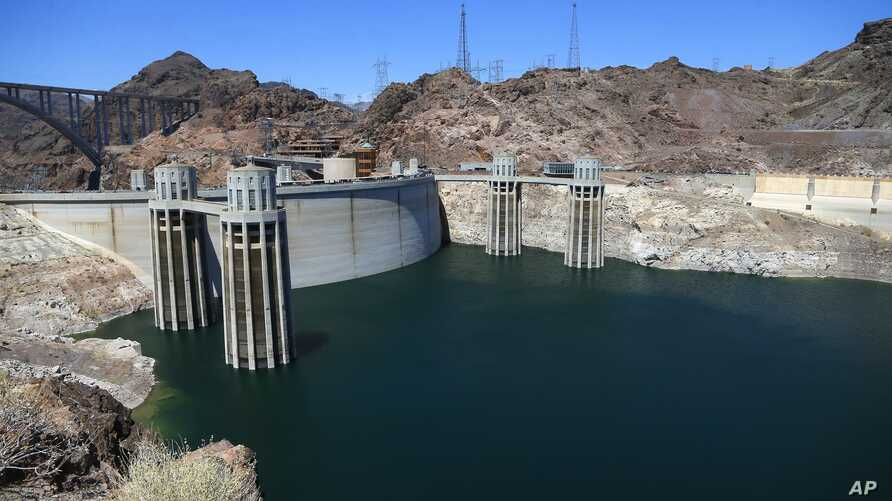 The low level of the water line is shown on the banks of the Colorado River at the Hoover Dam in Hoover Dam, Arizona, May 31, 2018.