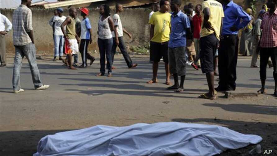 The body of a man killed is laid on a street in Bujumbura, Burundi after polls opened for the presidential elections Tuesday, July 21, 2015. Violence began in April after President Pierre Nkurnziza announced he would seek a third term in office, whic...