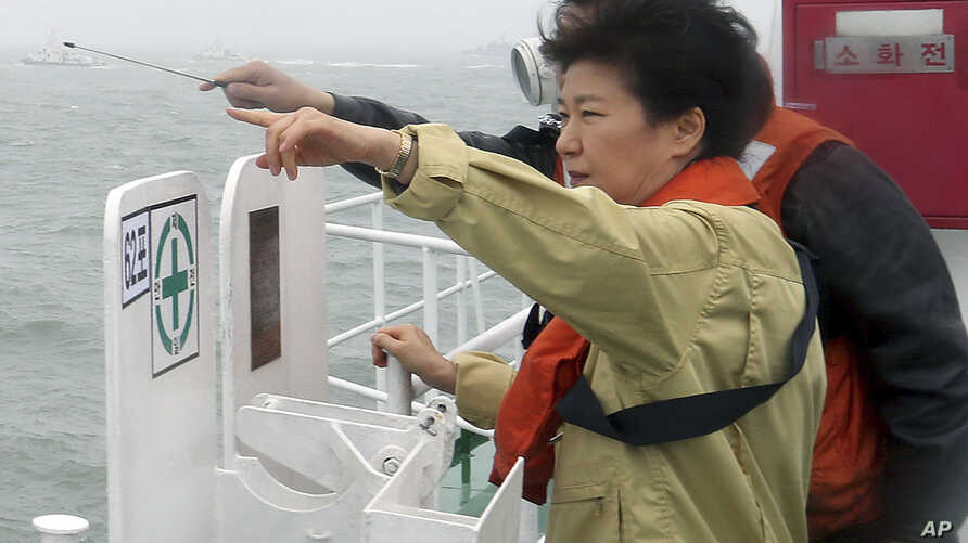 South Korean President Park Geun-hye looks at the site where the Sewol sank from aboard a Coast Guard ship in waters off the southern coast near Jindo, South Korea, Thursday, April 17, 2014.