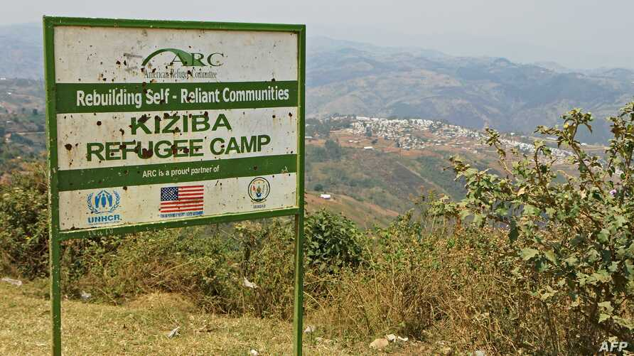 FILE - Picture showing the entrance placard of the Kiziba camp in western Rwanda, Sept. 6, 2016.