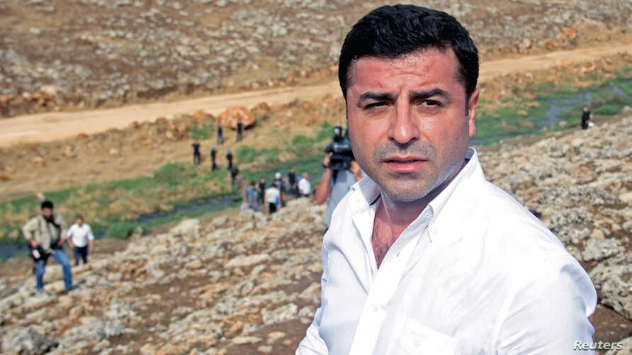 Co-chairman of the pro-Kurdish Peoples' Democratic Party, Selahattin Demirtas walks with his party members to the southeastern town of Cizre, near Idil in Sirnak province, Turkey, Sept. 10, 2015.